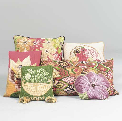 A GROUP OF NEEDLEPOINT PILLOWS