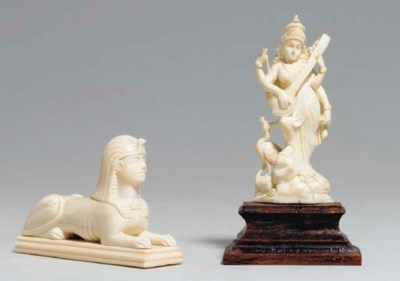 A GROUP OF TWELVE CARVED IVORY