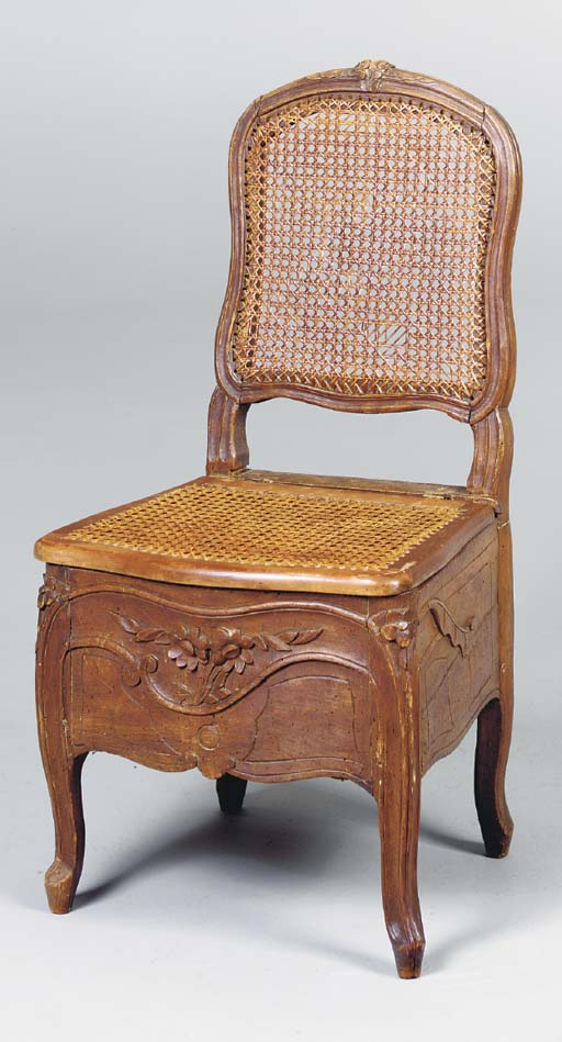 A PROVINCIAL LOUIS XV COMMODE