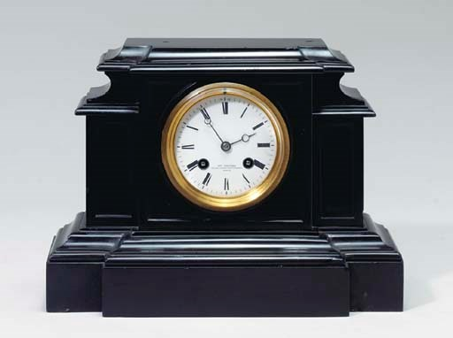 A MOLDED BLACK MARBLE MANTLE C