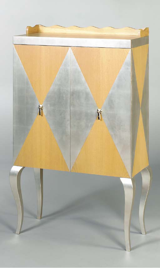 A PAIR OF SILVER LACQUERED BIR