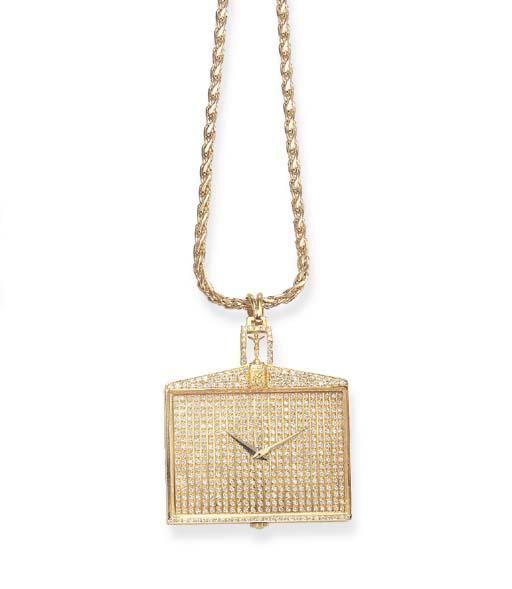 A DIAMOND AND GOLD PENDANT WAT