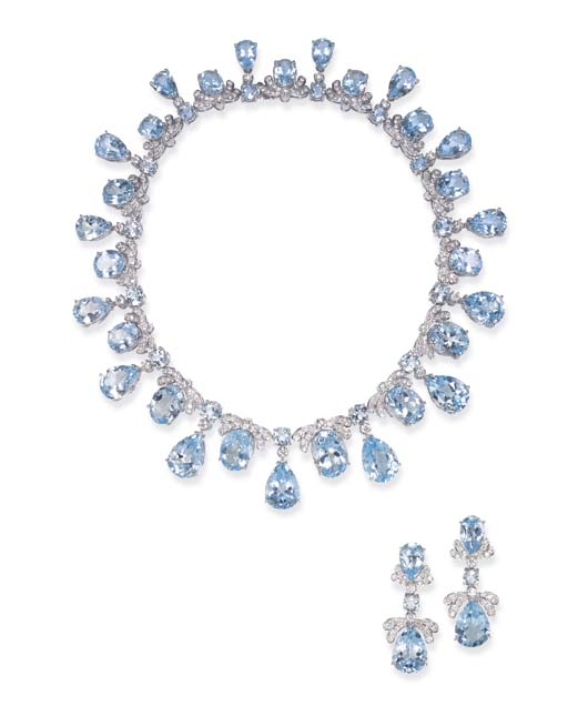 A SUITE OF TOPAZ AND DIAMOND J