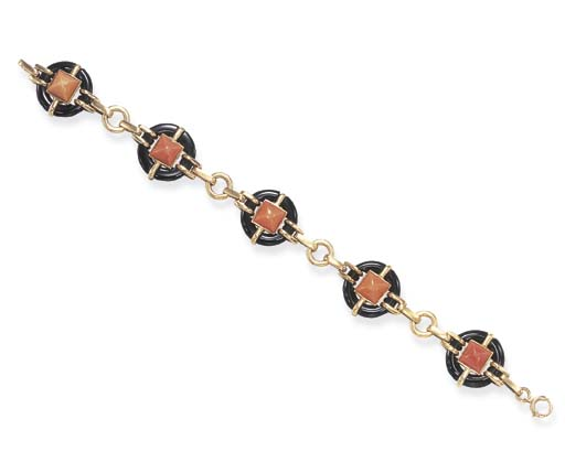 **AN ART DECO CORAL AND ONYX B