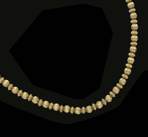 A FLUTED 18K GOLD BEAD NECKLAC