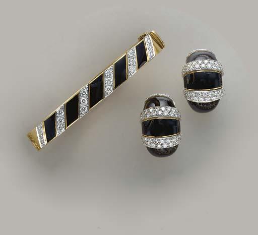 A SET OF DIAMOND, ENAMEL AND 1