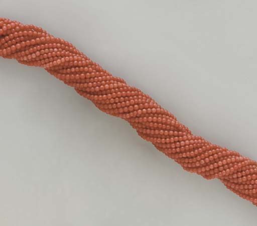 **A MULTI-STRAND CORAL, DIAMON