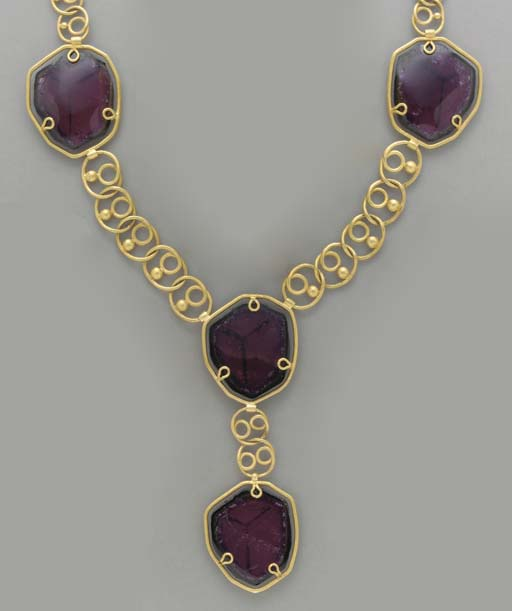 A TOURMALINE AND 22K GOLD NECK