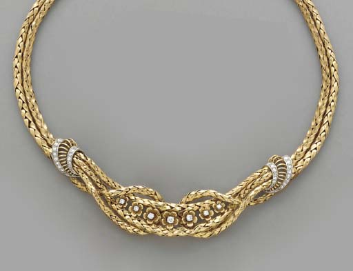 A DIAMOND AND 18K GOLD NECKLAC