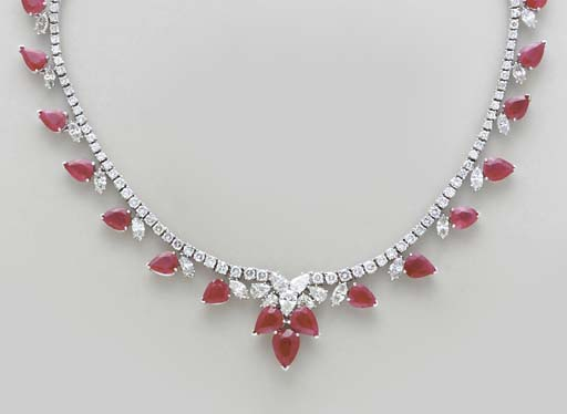 A RUBY, DIAMOND AND WHITE GOLD