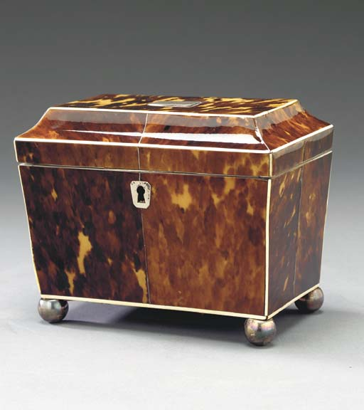 A REGENCY IVORY-INLAID AND SILVER-MOUNTED TORTOISESHELL TEA CADDY**