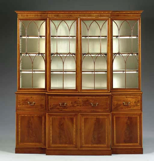 A VICTORIAN MAHOGANY AND SATINWOOD BREAKFRONT-SECRETAIRE BOOKCASE