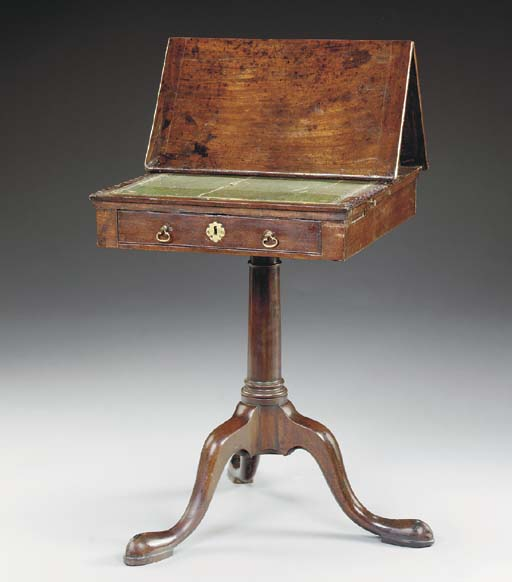 A GEORGE III MAHOGANY READING-TABLE