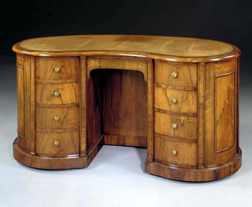 AN EARLY VICTORIAN ROSEWOOD KIDNEY-SHAPED DESK