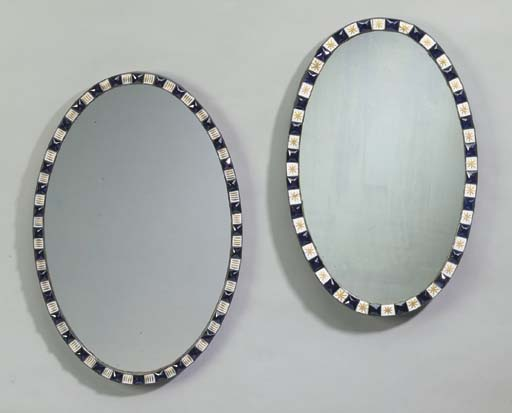 TWO IRISH GEORGE III COBALT BLUE, OPAQUE AND GILT-HIGHLIGHTED GLASS OVAL MIRRORS
