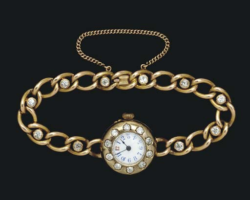 A JEWELED GOLD-MOUNTED WRISTWA