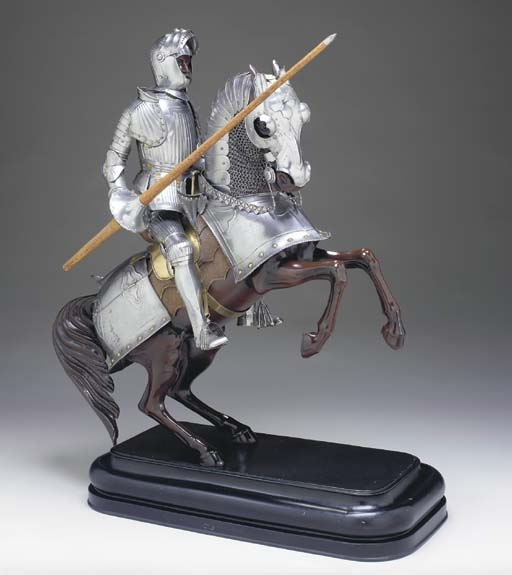 A MINIATURE SUIT OF ARMOR OF M