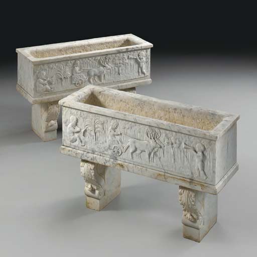 A pair of Italian carved grey-