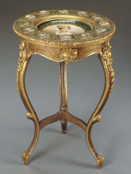 A giltwood and Hutschenreuther