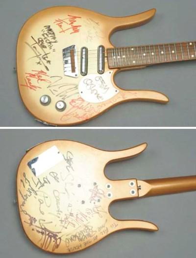 MOTLEY CRUE SIGNED GUITAR