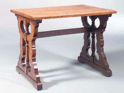 AN OAK TRESTLE TABLE,