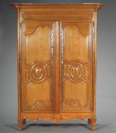 A PROVINCIAL LOUIS XV CARVED O