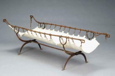 A FOLDING IRON CAMPAIGN BED,