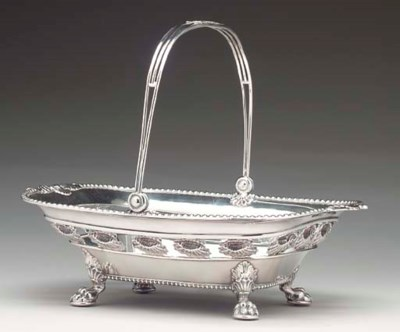 A SILVER-PLATED CAKE BASKET,