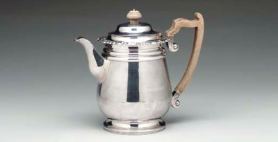 A SILVER-PLATED COFFEE POT,