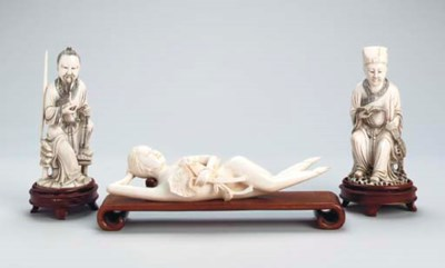 FOUR CHINESE CARVED IVORY FIGU