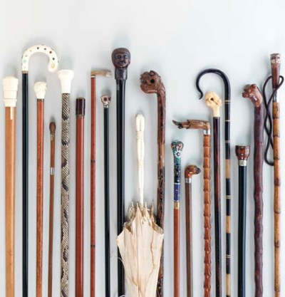 A GROUP OF VARIOUS CANES AND W