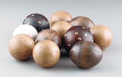 A GROUP OF CARPET BALLS,