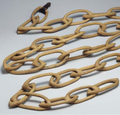 A CARVED WOODEN CHAIN,