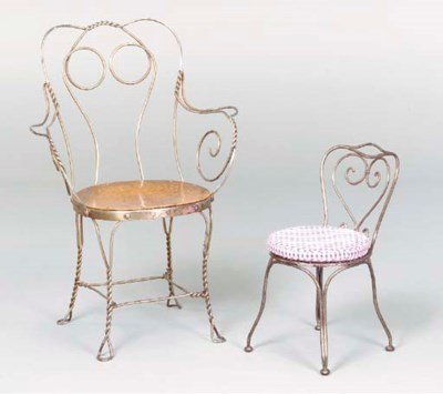 A VICTORIAN STEEL ARM CHAIR AN