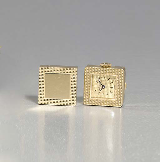 LECOULTRE. A 14K GOLD PAIR OF