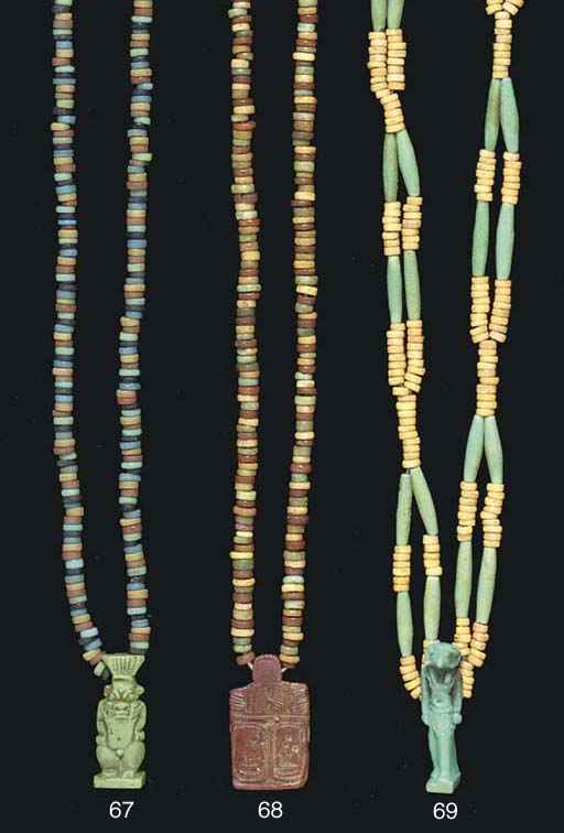 AN EGYPTIAN FAIENCE AMULET OF
