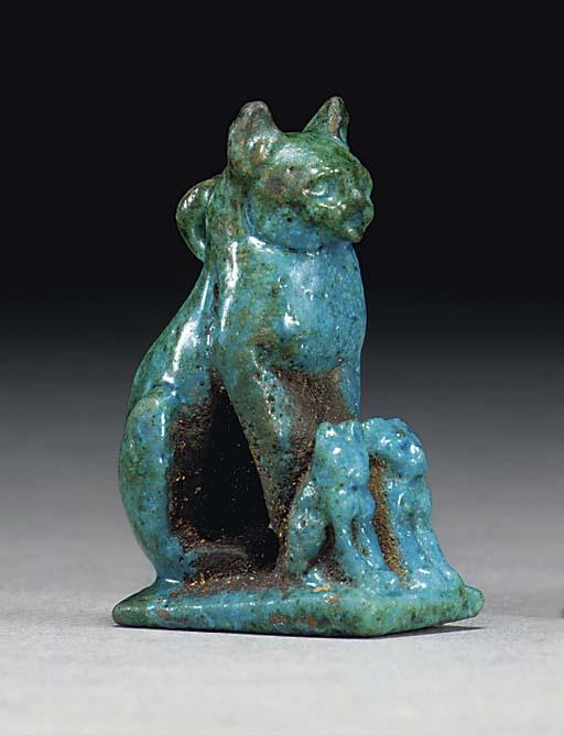 AN EGYPTIAN FAIENCE SEATED CAT