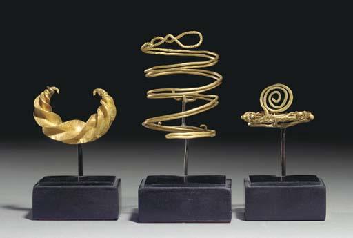 THREE EARLY EUROPEAN GOLD ORNA