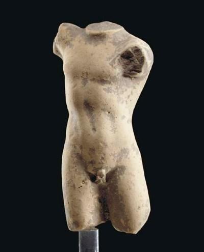 A GREEK TERRACOTTA TORSO OF AN