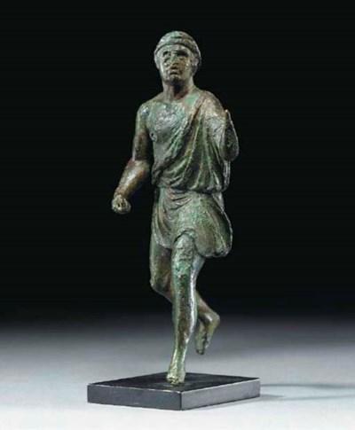 A ROMAN BRONZE RUNNING MAN