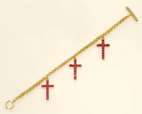 A RUBY AND GOLD BRACELET, BY A