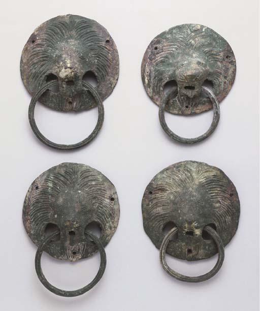 FOUR ROMAN BRONZE LION-HEAD AP
