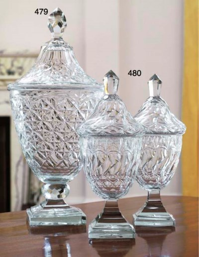 A CUT-GLASS FOOTED JAR AND COV