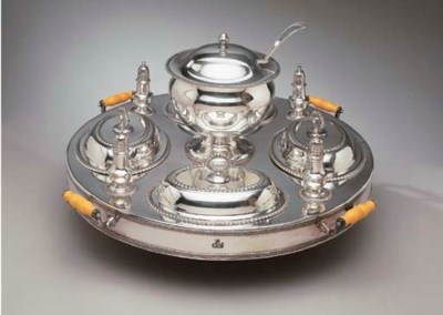 A SILVER-PLATED REVOLVING SUPP