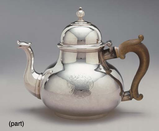 A QUEEN ANNE SILVER TEAPOT AND