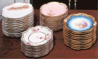 FOUR SETS OF LIMOGES PORCELAIN