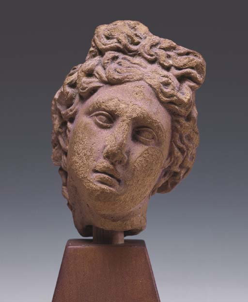 A GREEK TERRACOTTA HEAD OF APO