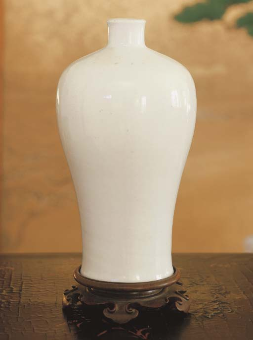 A CHINESE WHITE-GLAZED INCISED