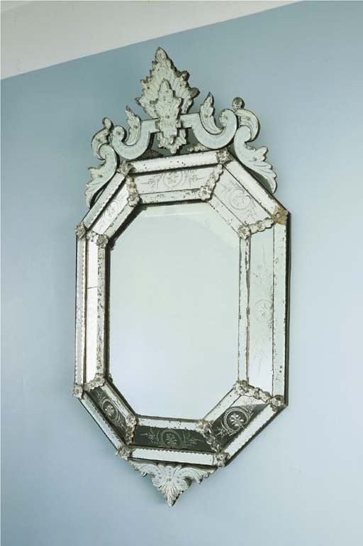 AN ITALIAN ETCHED-GLASS MIRROR