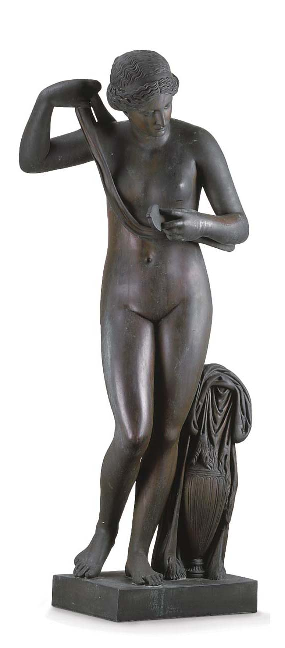 A BRONZE FEMALE MOURNING FIGUR